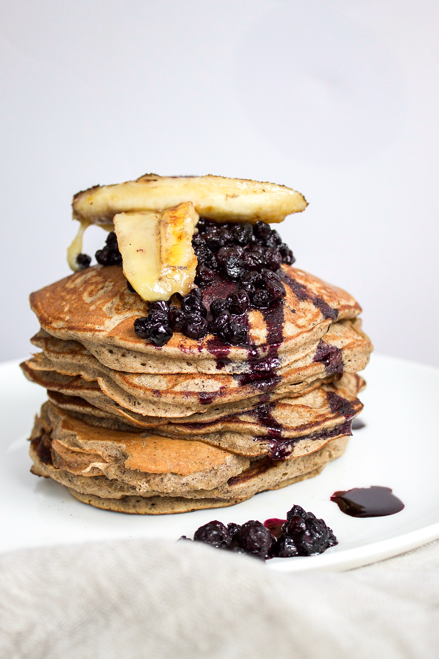 Cinnamon Buckwheat Pancakes With Blueberry Syrup And Caramelized Bananas